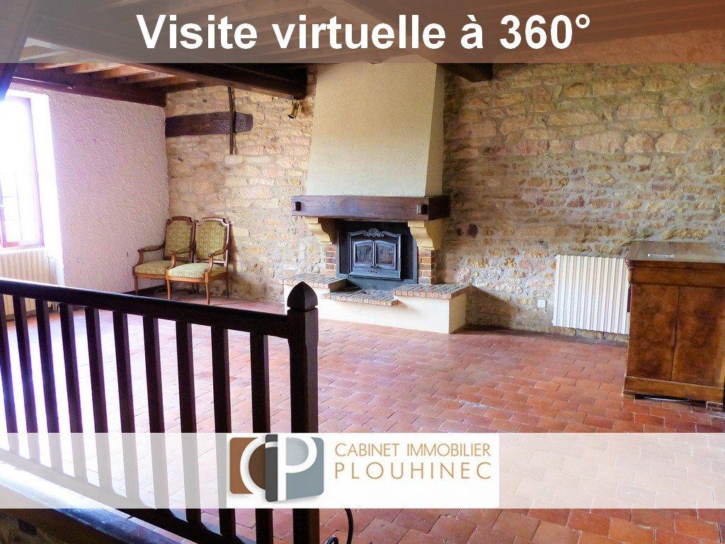 SOUS COMPROMIS DE VENTE 20 mn de Mâcon, au sein du village de Lugny, maison de caractère à rénover. Elle se compose, en rez de chaussée, d'une salle à manger avec cuisine aménagée, salle de bain, wc et chaufferie. A l'étage, magnifique séjour de 36.5 m² avec très belle cheminée et murs en pierre donnant énormément de charme à la pièce. Côté nuit, la maison dispose d'une chambre de plus de 20 m² avec point d'eau et wc, d'un bureau et d'une seconde chambre de 14.6 m². Attenant à la maison, grand garage de  37 m² et atelier  de 45 m².  Le plus de cette maison de village: à 5 mètres de la maison, qui est située dans une impasse, jardinet clôt de 180 m² avec maisonnette en pierre. Aucune nuisances, très belle vue sur les monts environnants, cachet, potentiel etc... Beaucoup d'atouts pour cette maison coup de c?ur !! A visiter sans tarder! Honoraires à charge vendeurs.