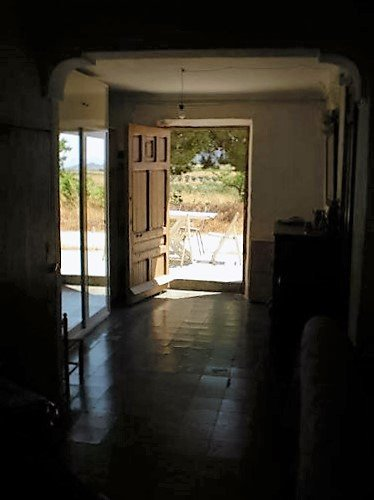 Large farmhouse situated in beautiful surroundings in a valley of natural beauty.