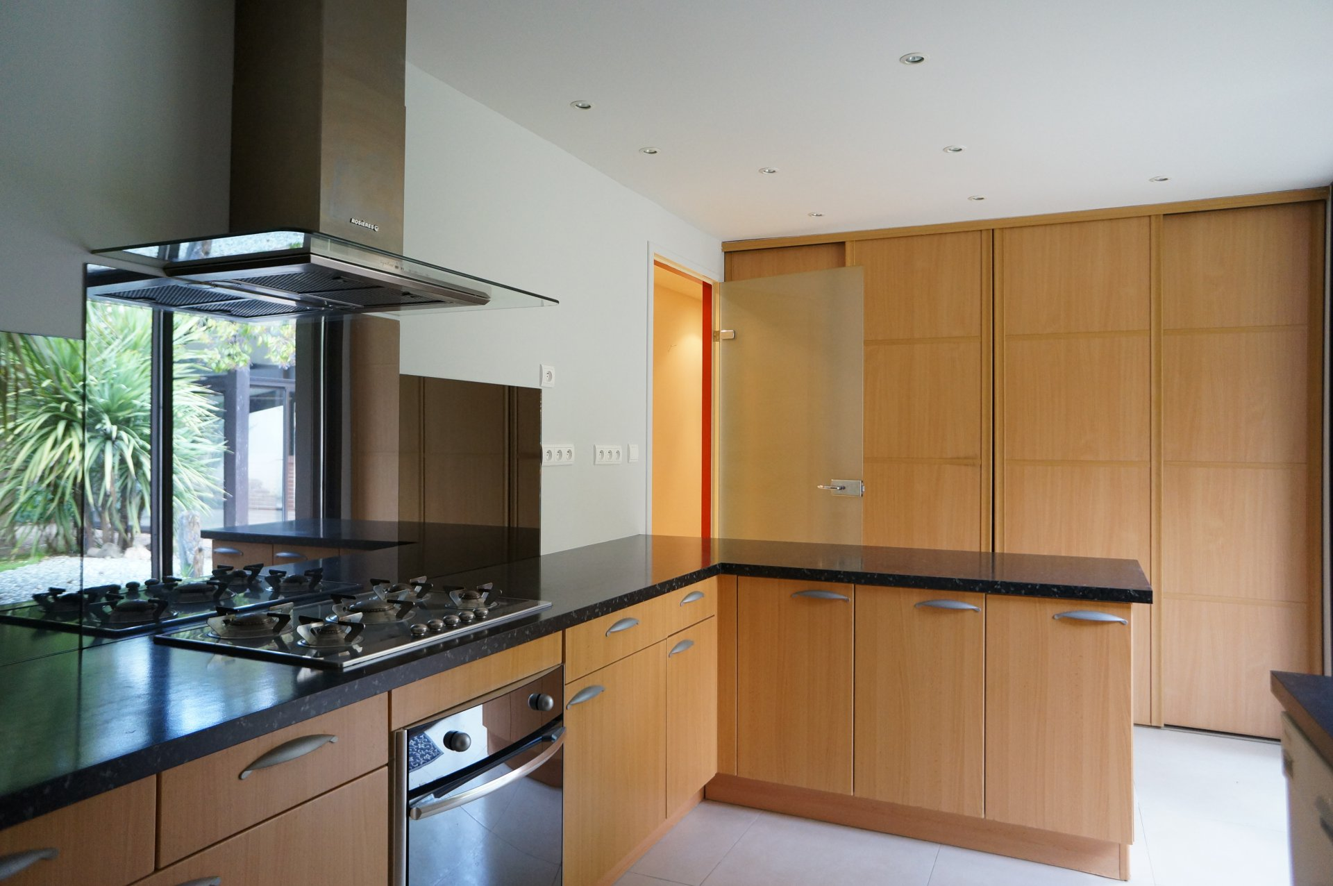 Kitchen, stainless steel, natural light, fireplace, tile