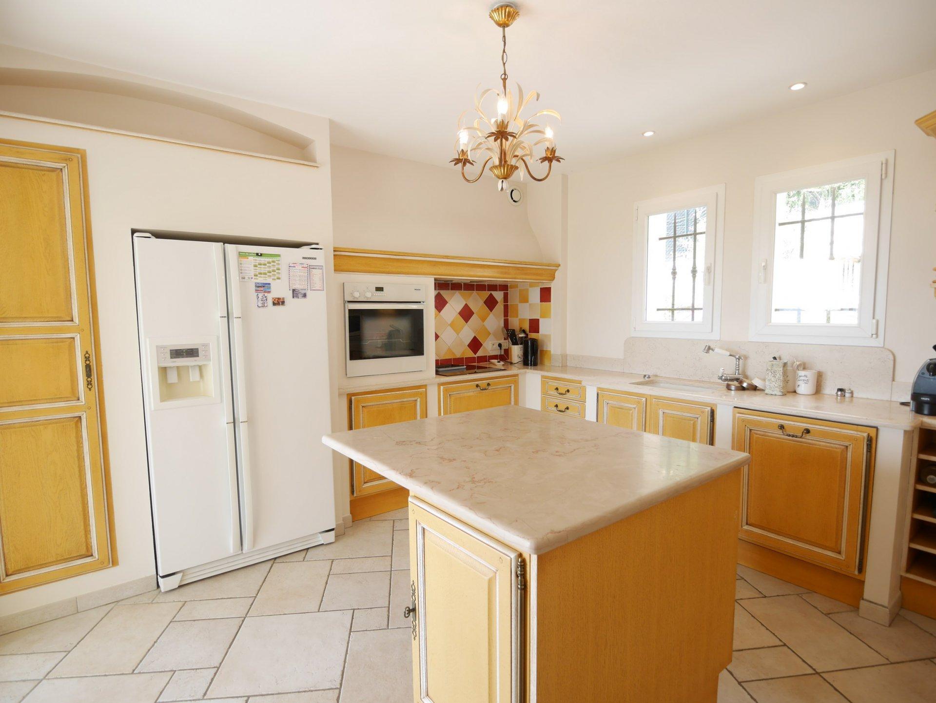 Kitchen island, chandelier, stainless steel