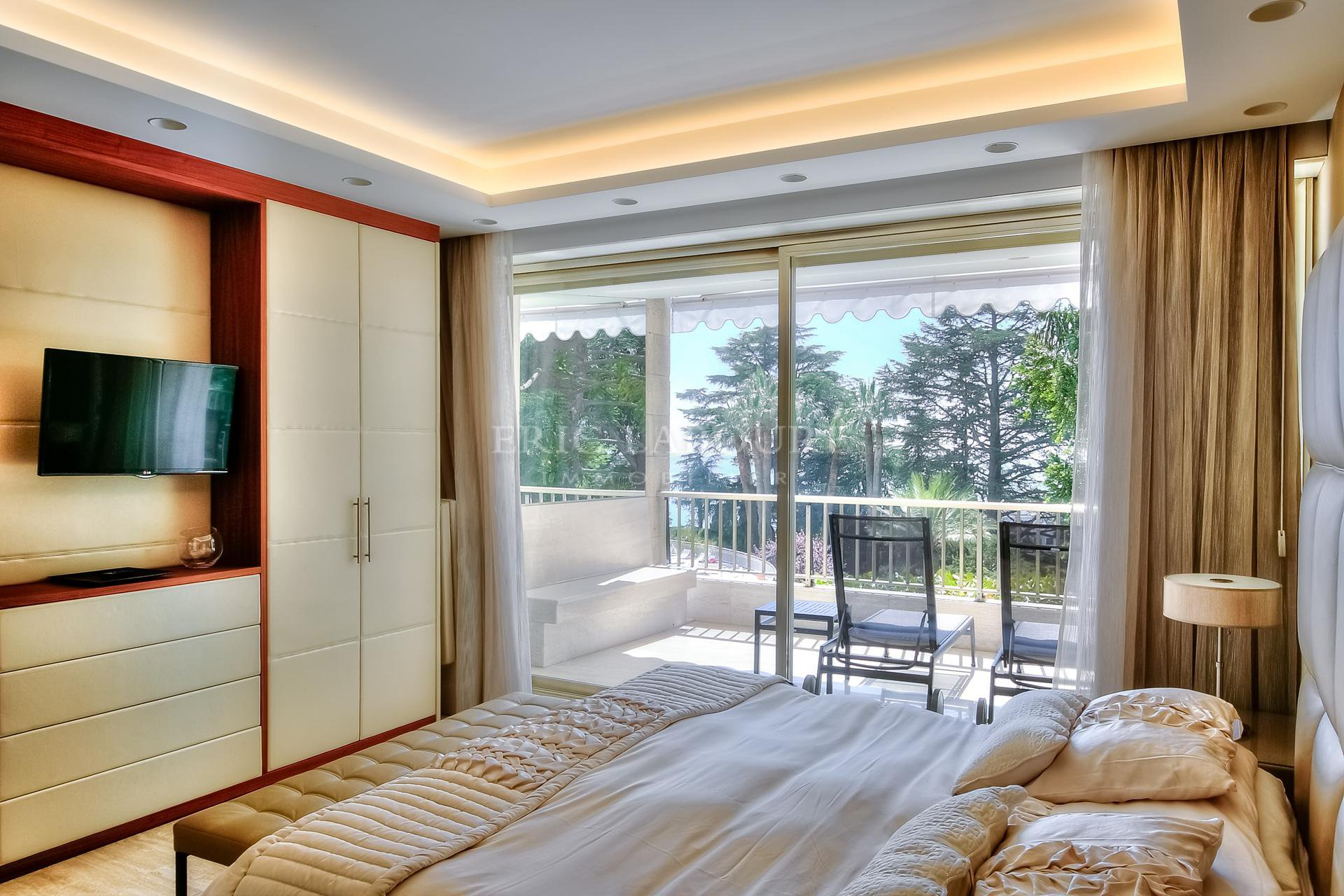Master bedroom opening on a large terrace