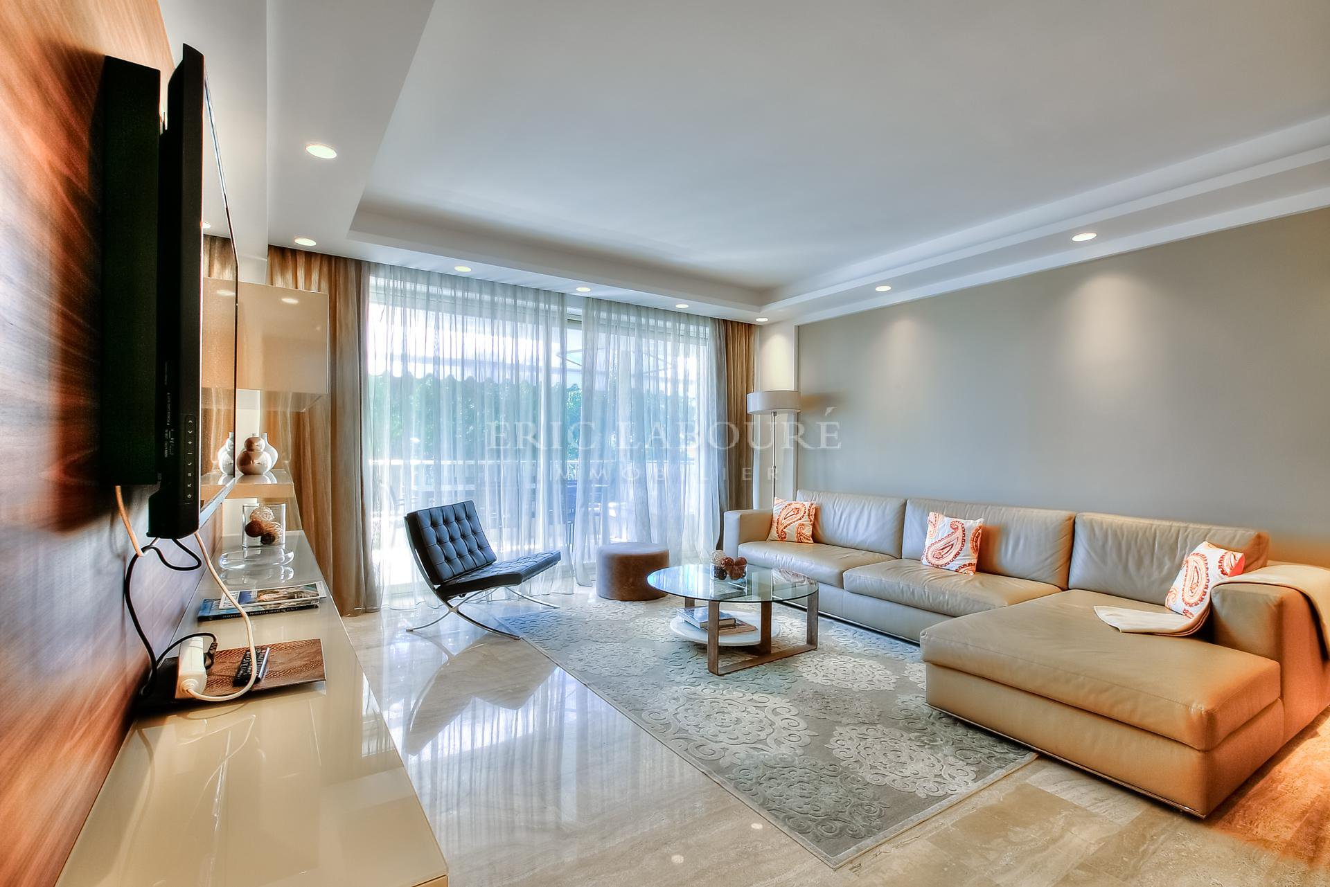 Living room opening on a large terrace