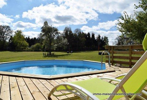 Te koop, Fermette met bijgebouwen, buiten bar, opbouwzwembad en terrein ( 8580m²)