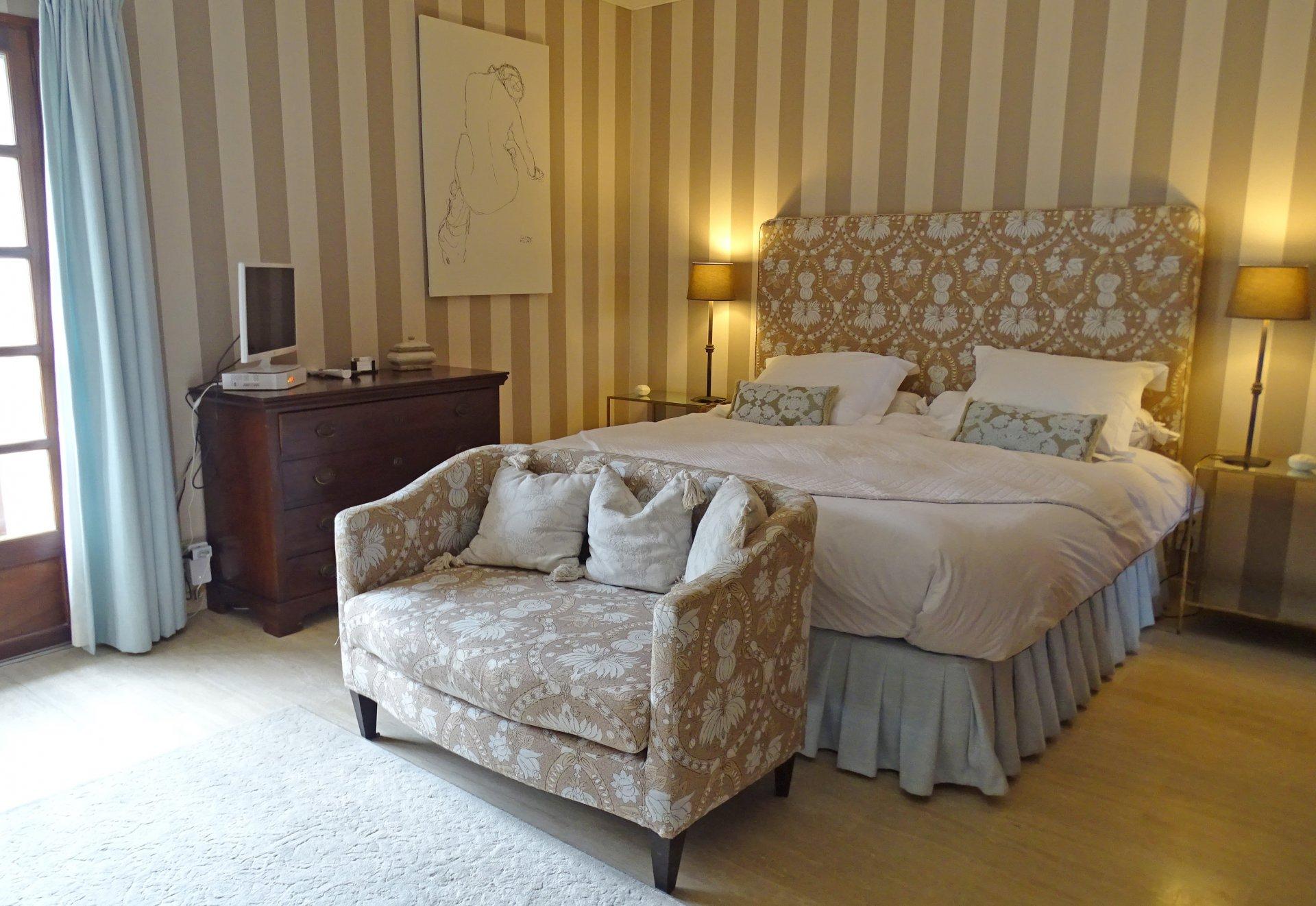 Bedroom, natural light, carpet, wood floors