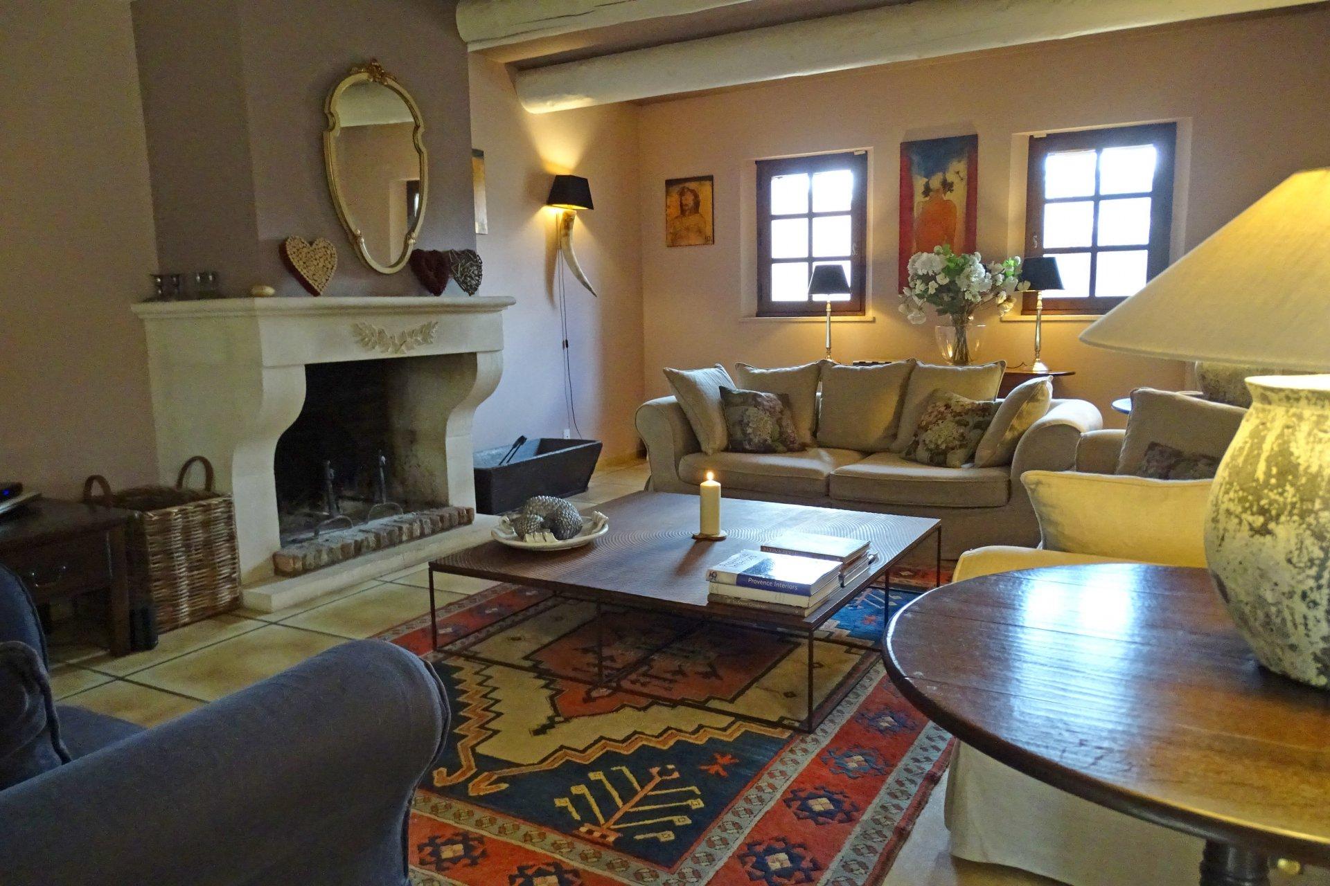 Living-room, natural light, fireplace, wood floors