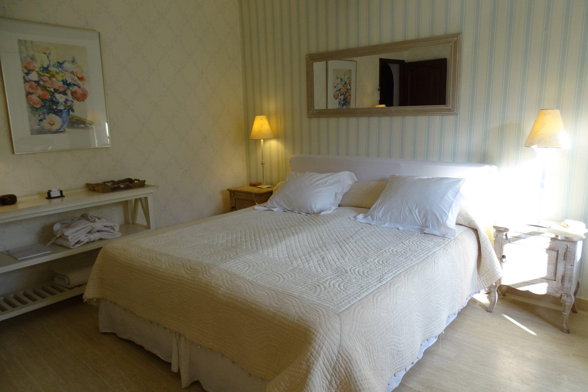 Bedroom, natural light, wood floors