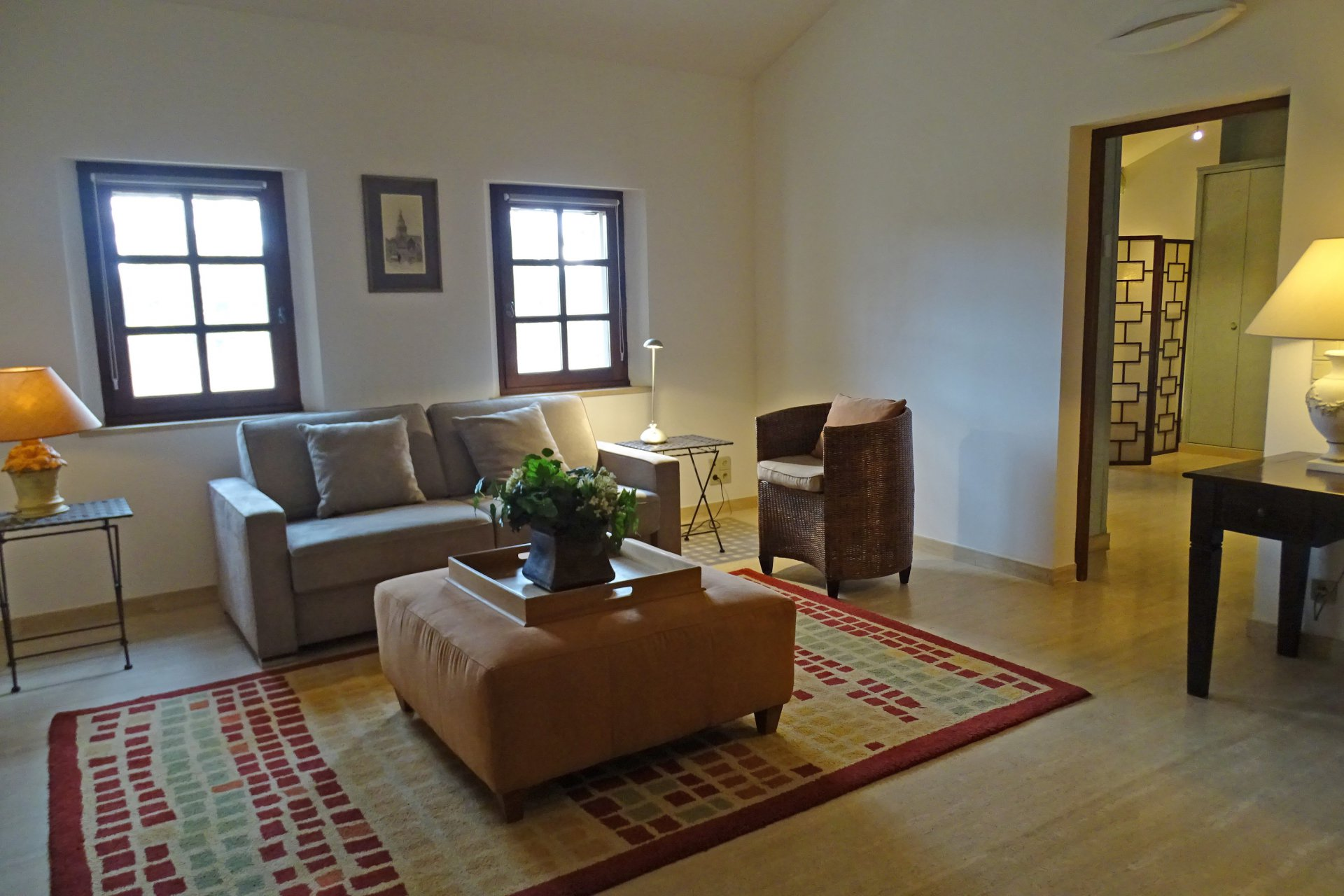 Living-room, natural light, high ceiling, wood floors