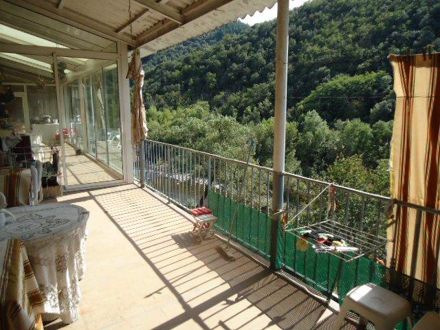 Appartement avec terrasse, véranda et jardin potager