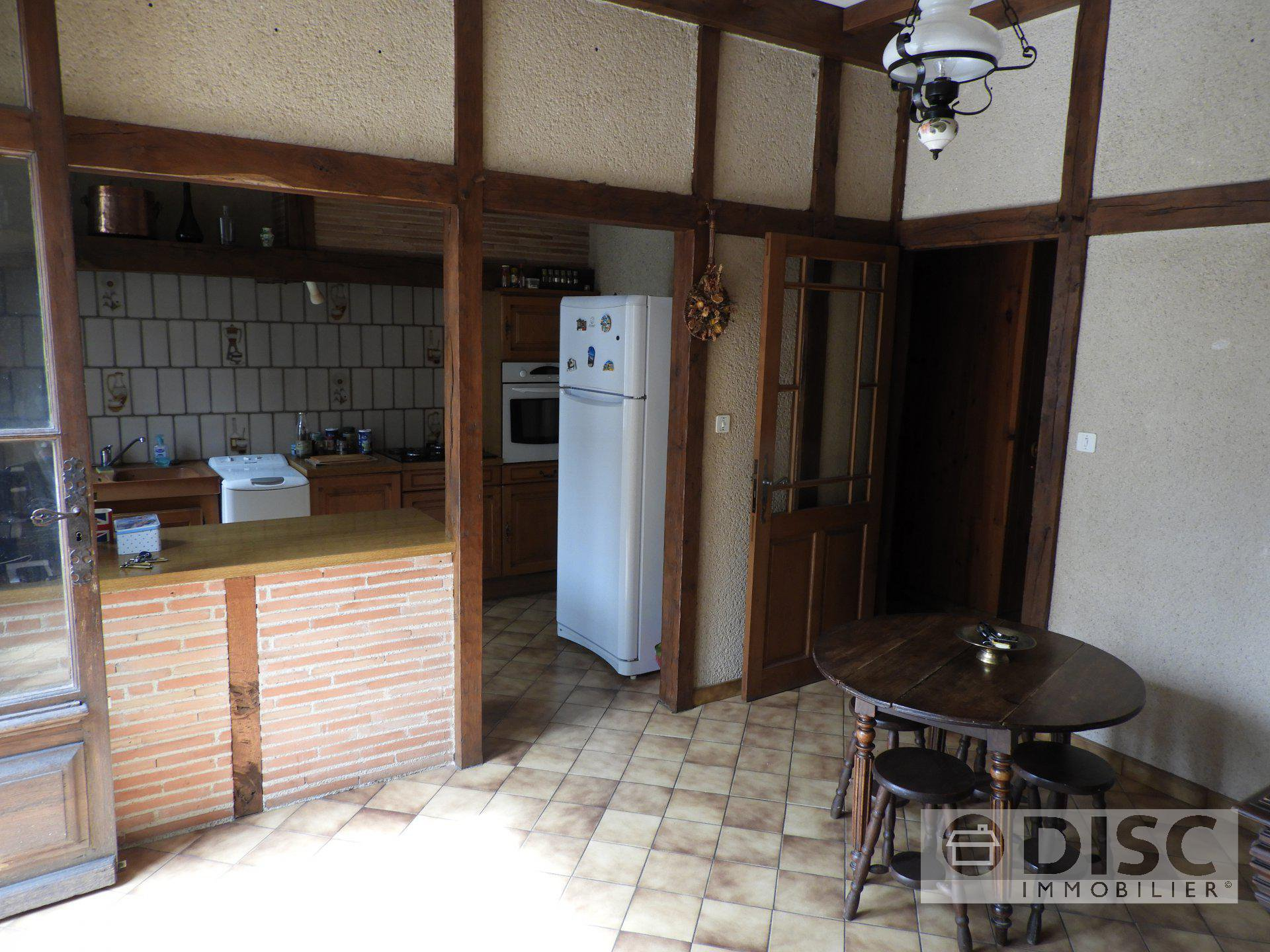 Spacious village house with garage and detached garden.