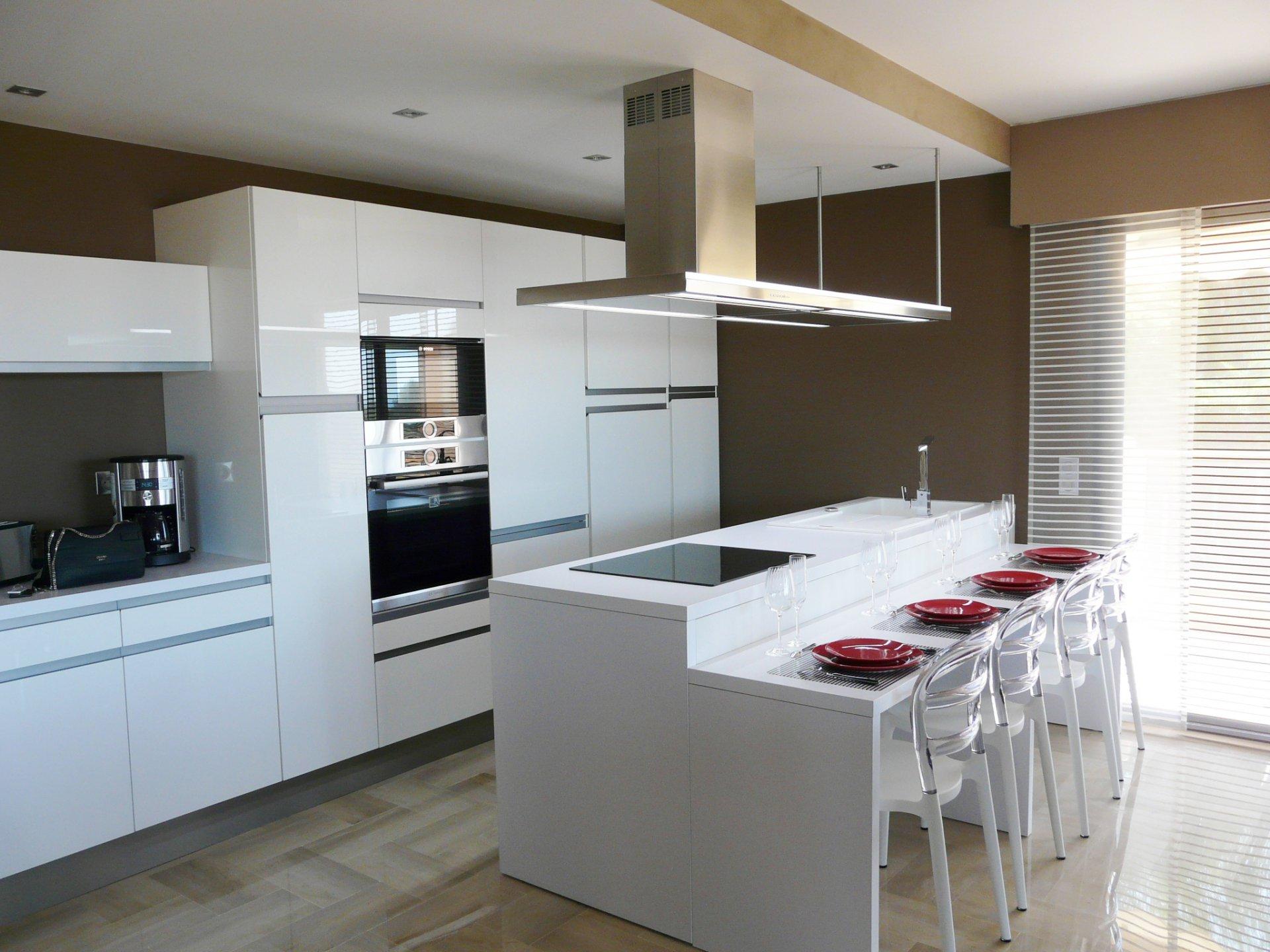 Stainless steel, natural light, kitchen island, kitchen bar