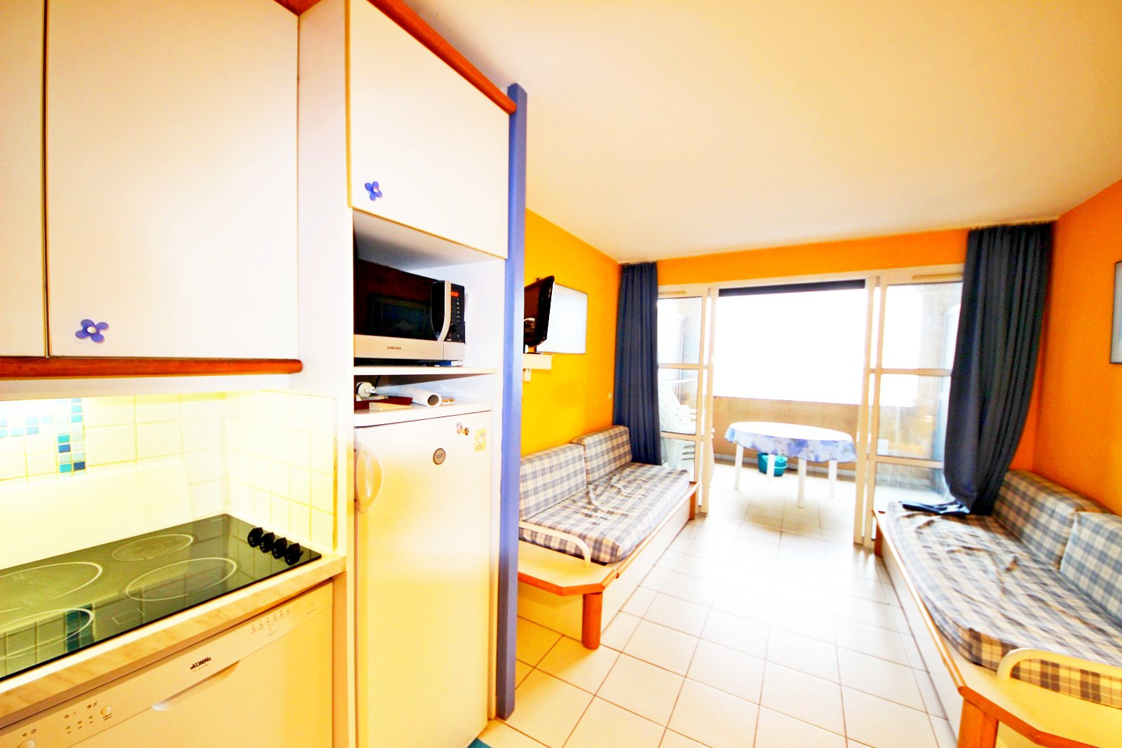The living room and kitchen of the Cap Estérel apartment