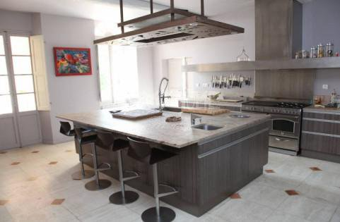 Natural light, stainless steel, kitchen bar, kitchen island