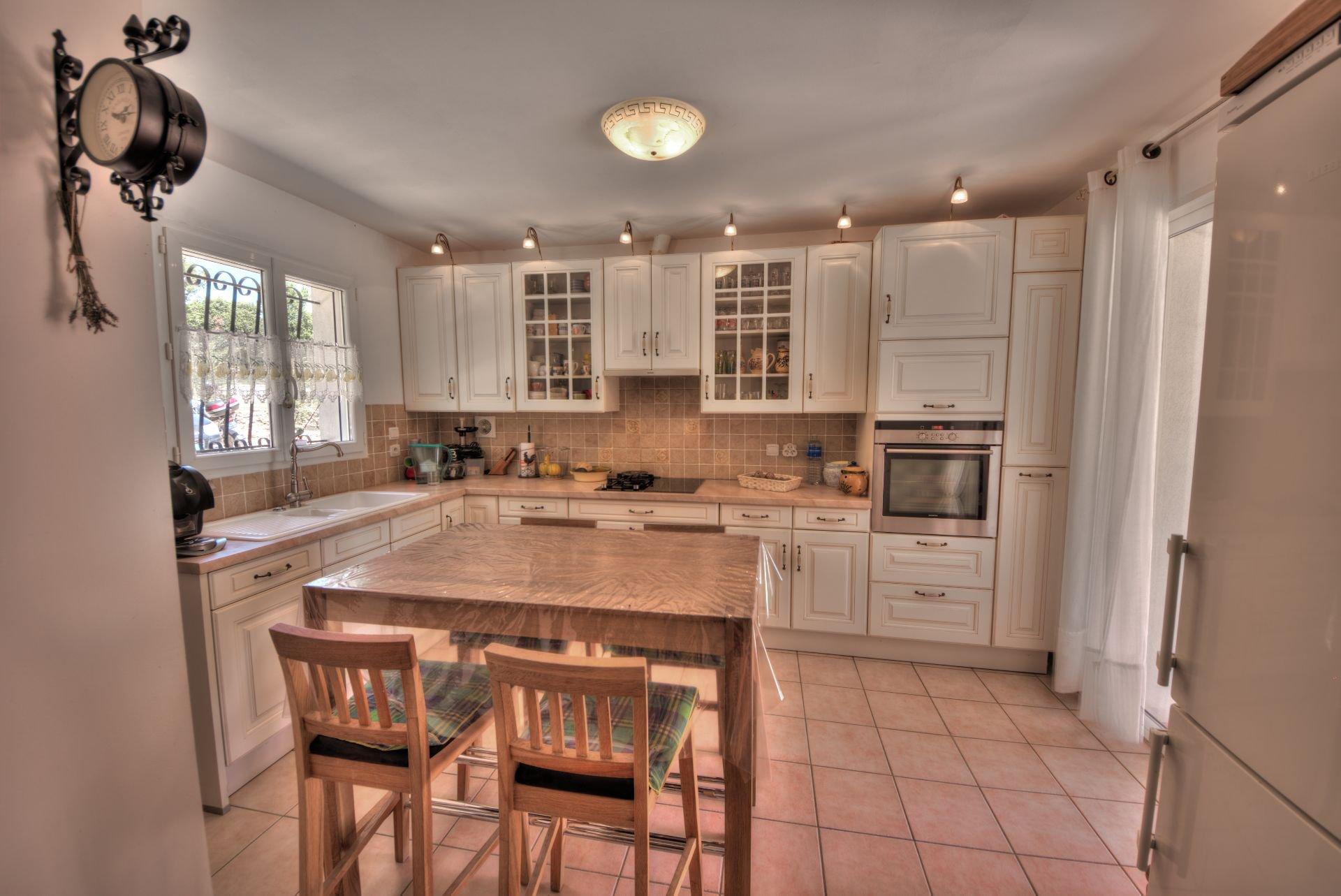 Natural light, stainless steel, kitchen island, kitchen bar