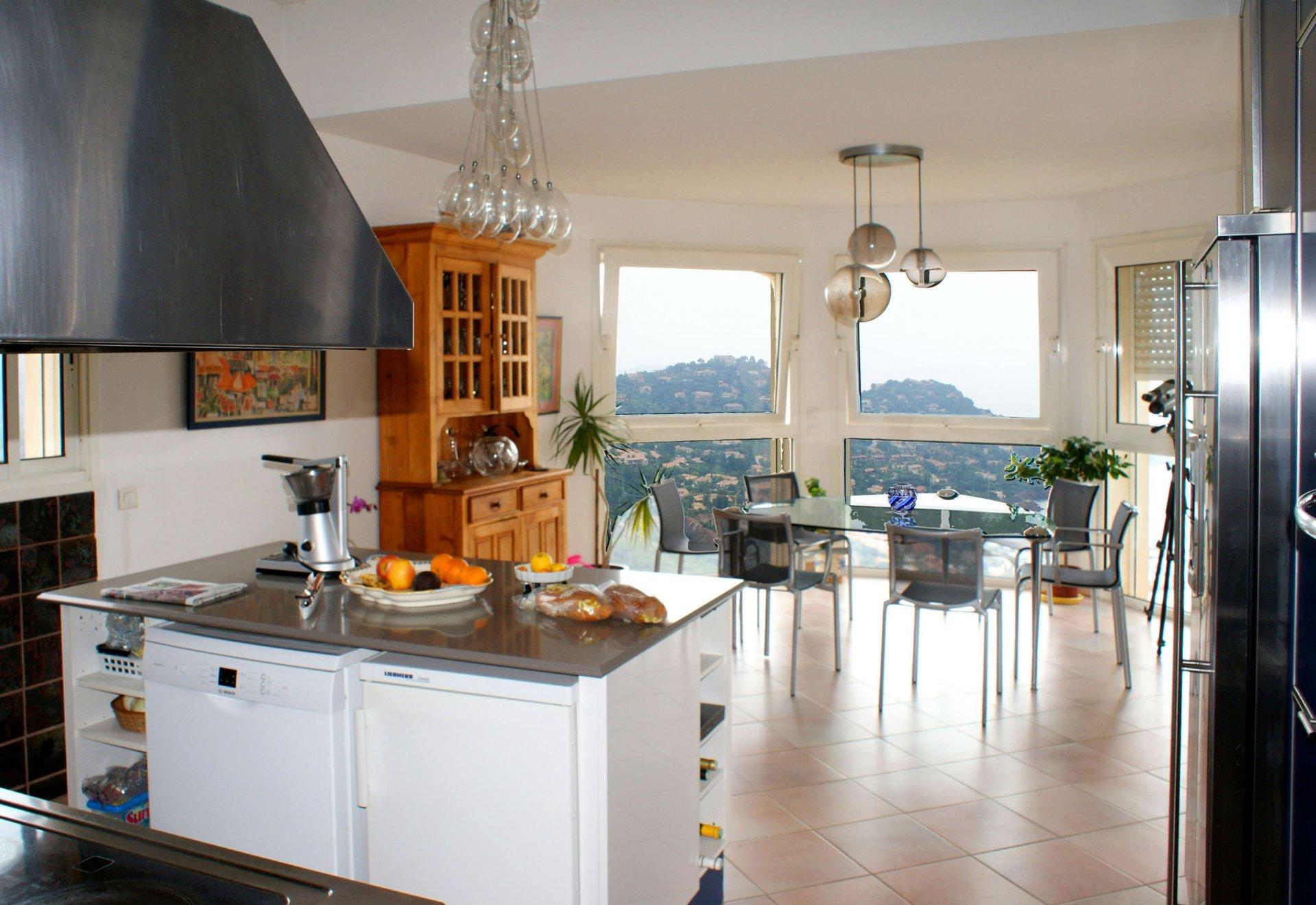 Chandelier, natural light, stainless steel, kitchen island