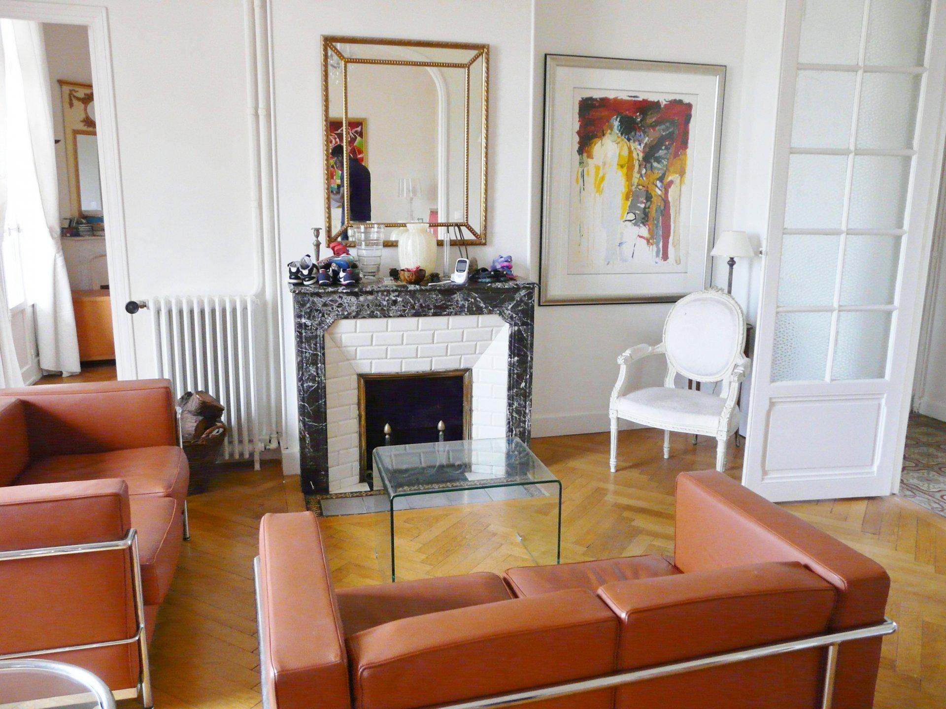 Living-room, natural light, bay-window, fireplace, wood floors