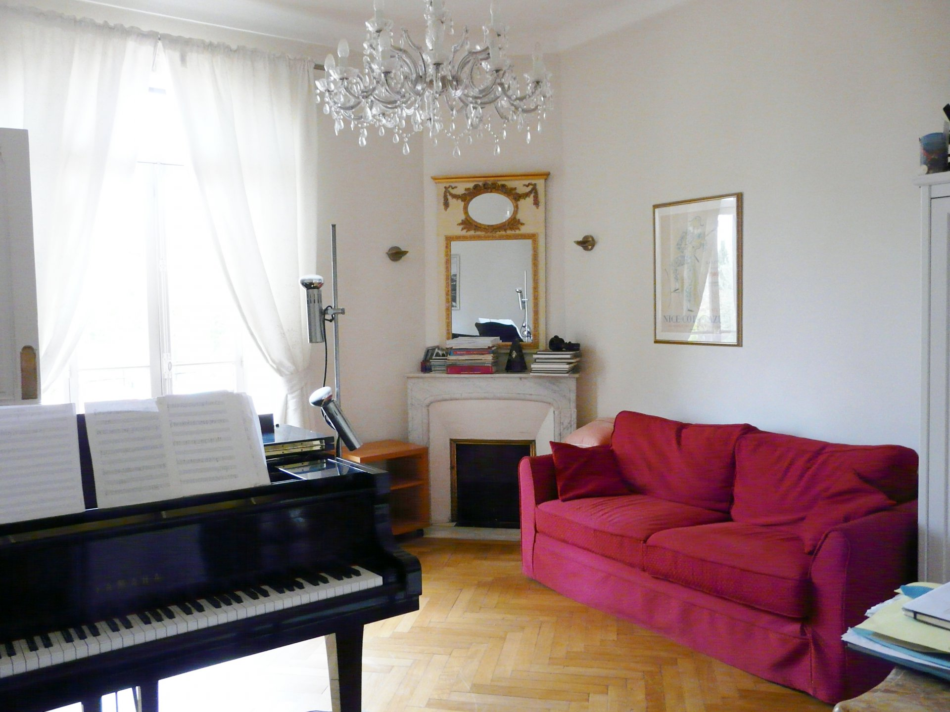 Living-room, chandelier, natural light, fireplace, wood floor