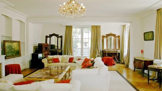 Living-room, chandelier, natural light, wood floors