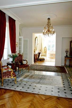 Entrance, chandelier, natural light, wood floors