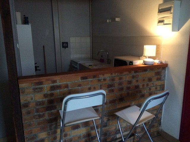 Exposed bricks, kitchen bar