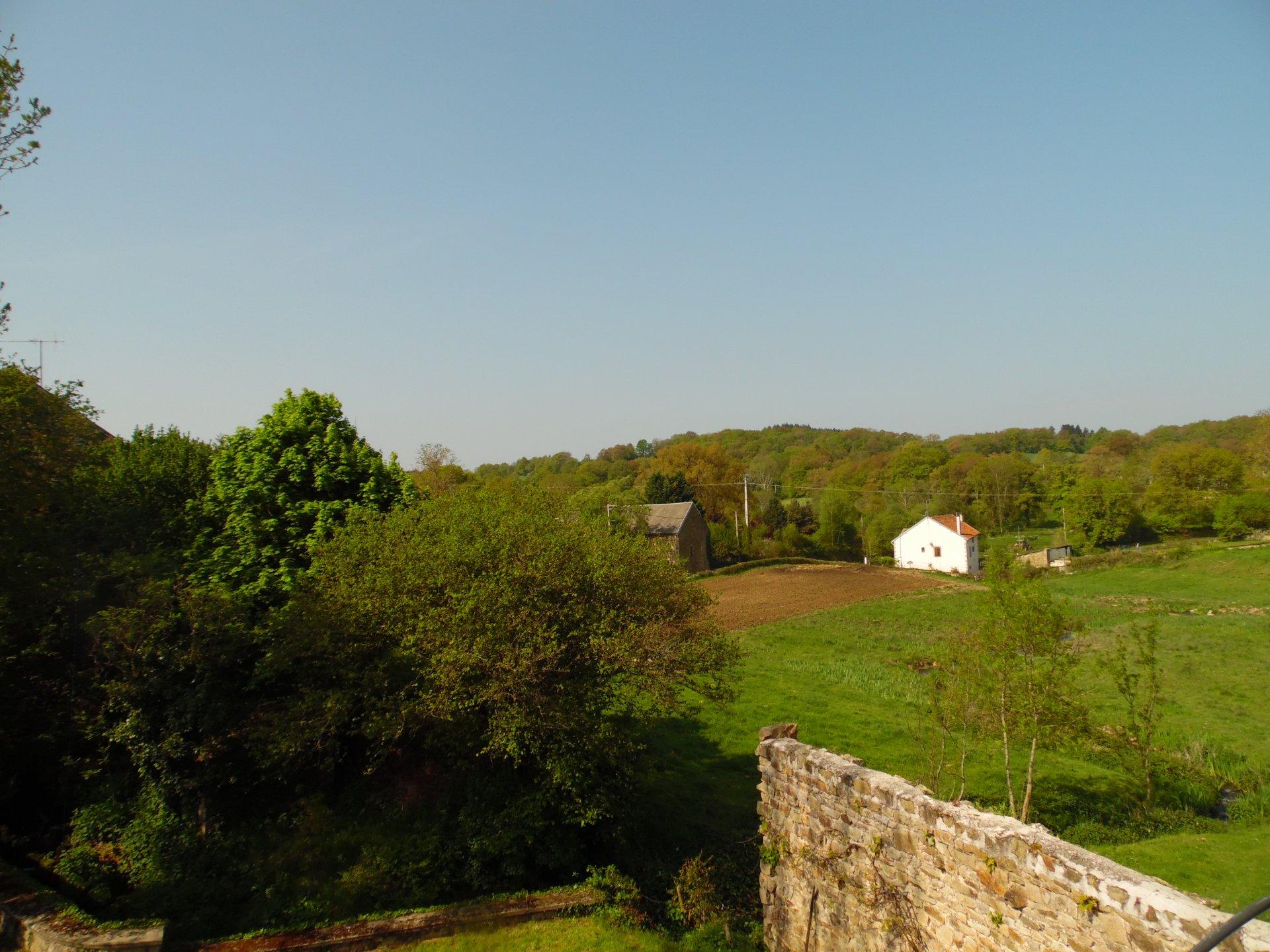 A vendre Maison (ancien moulin à eau) avec terrasse et jardin.