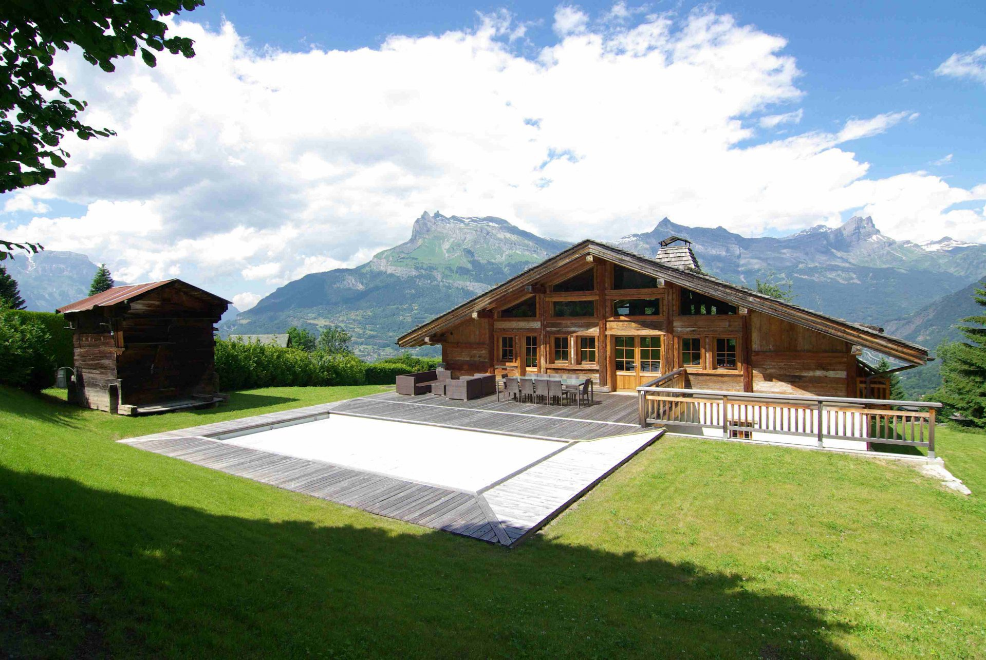 South facing view of the chalet with pool, mazot and the Mont-Blanc mountain range