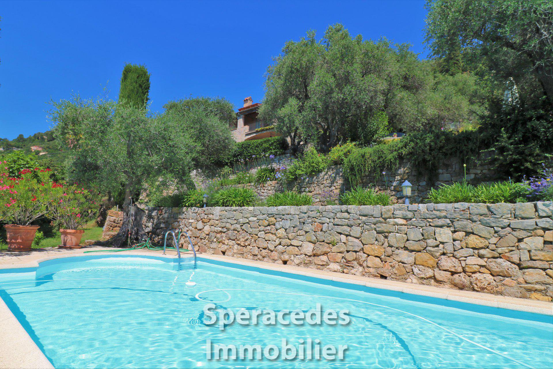 Swimming pool with house set in olive grove