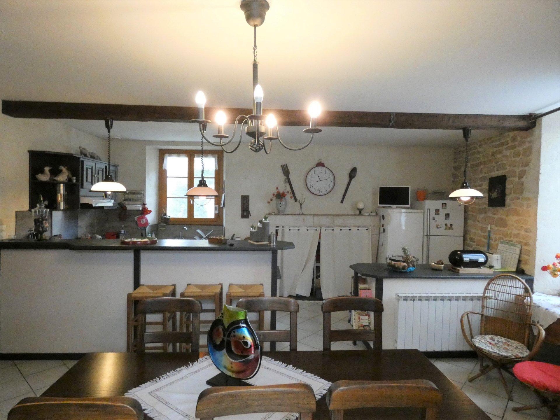 Kitchen bar, chandelier, exposed bricks