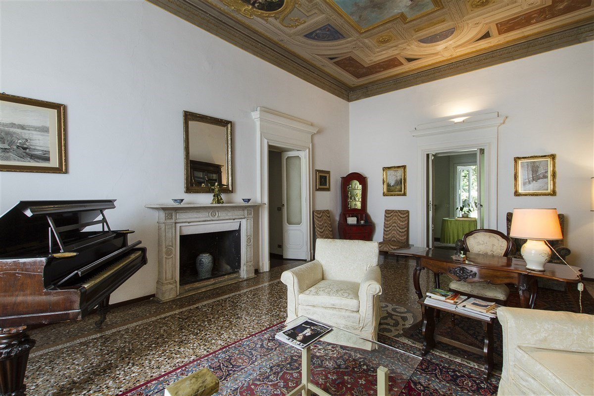 Historic villa for sale in Galliate - fireplace sitting room