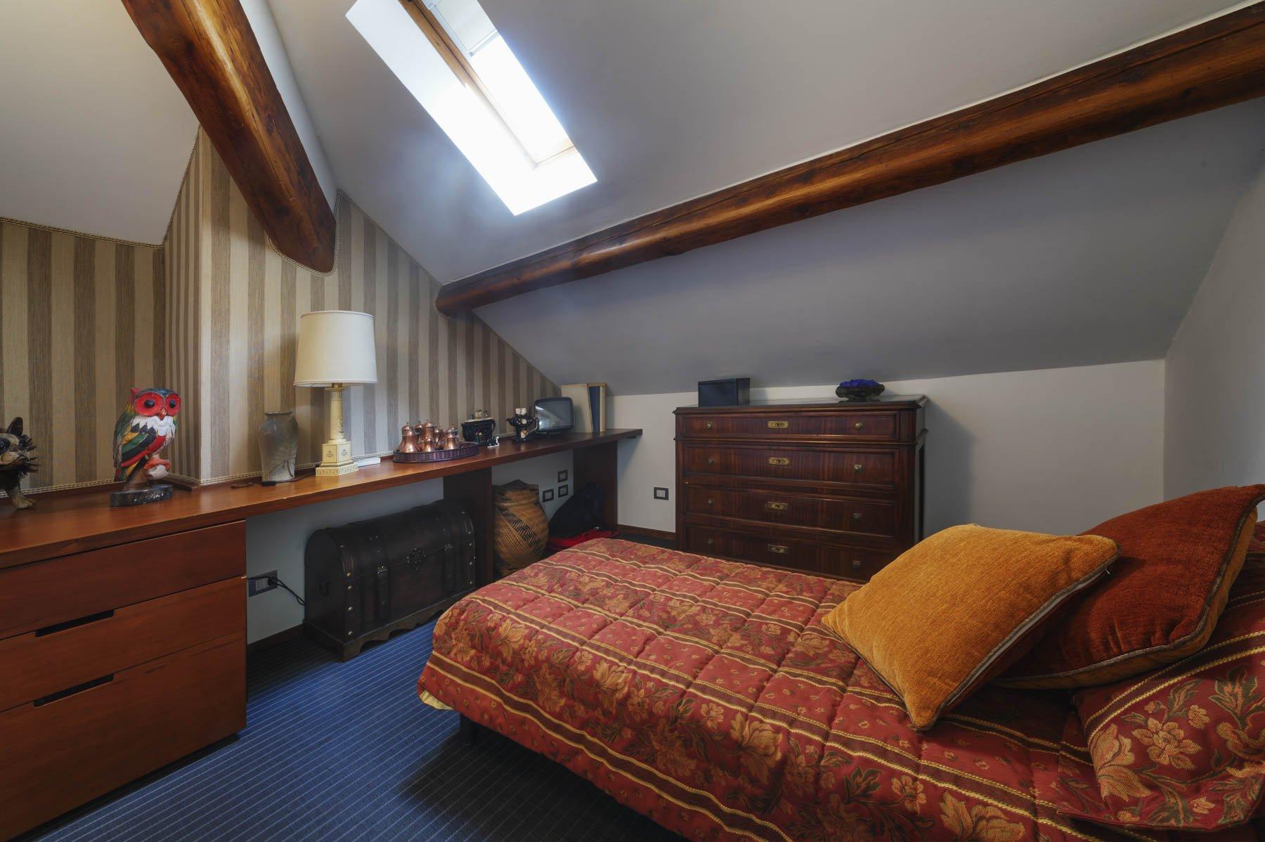 Apartment for sale in Baveno, inside a historic lake front villa . double bedroom in the attic