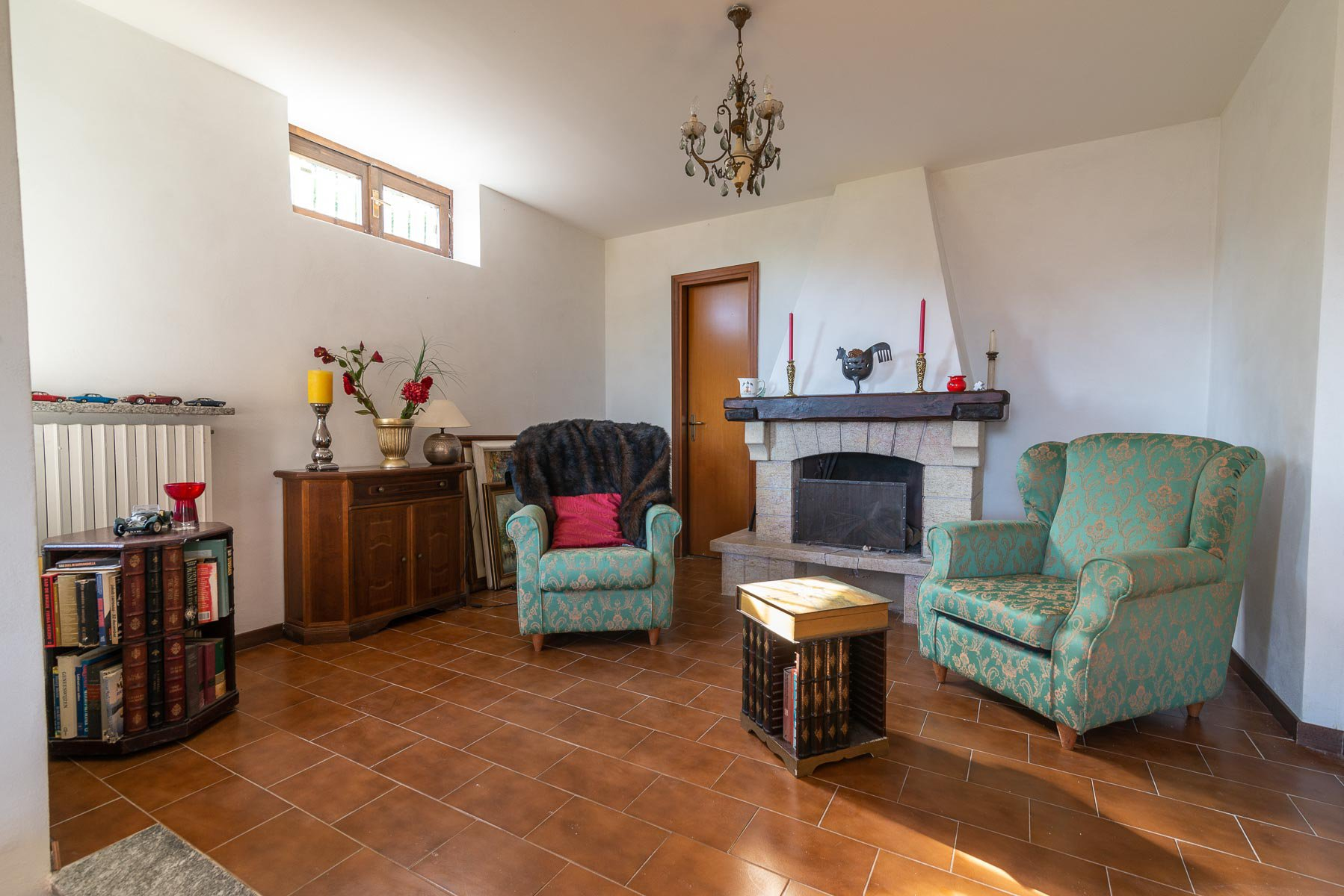 Villa for sale on the hill of Stresa with lake view- living room with fireplace