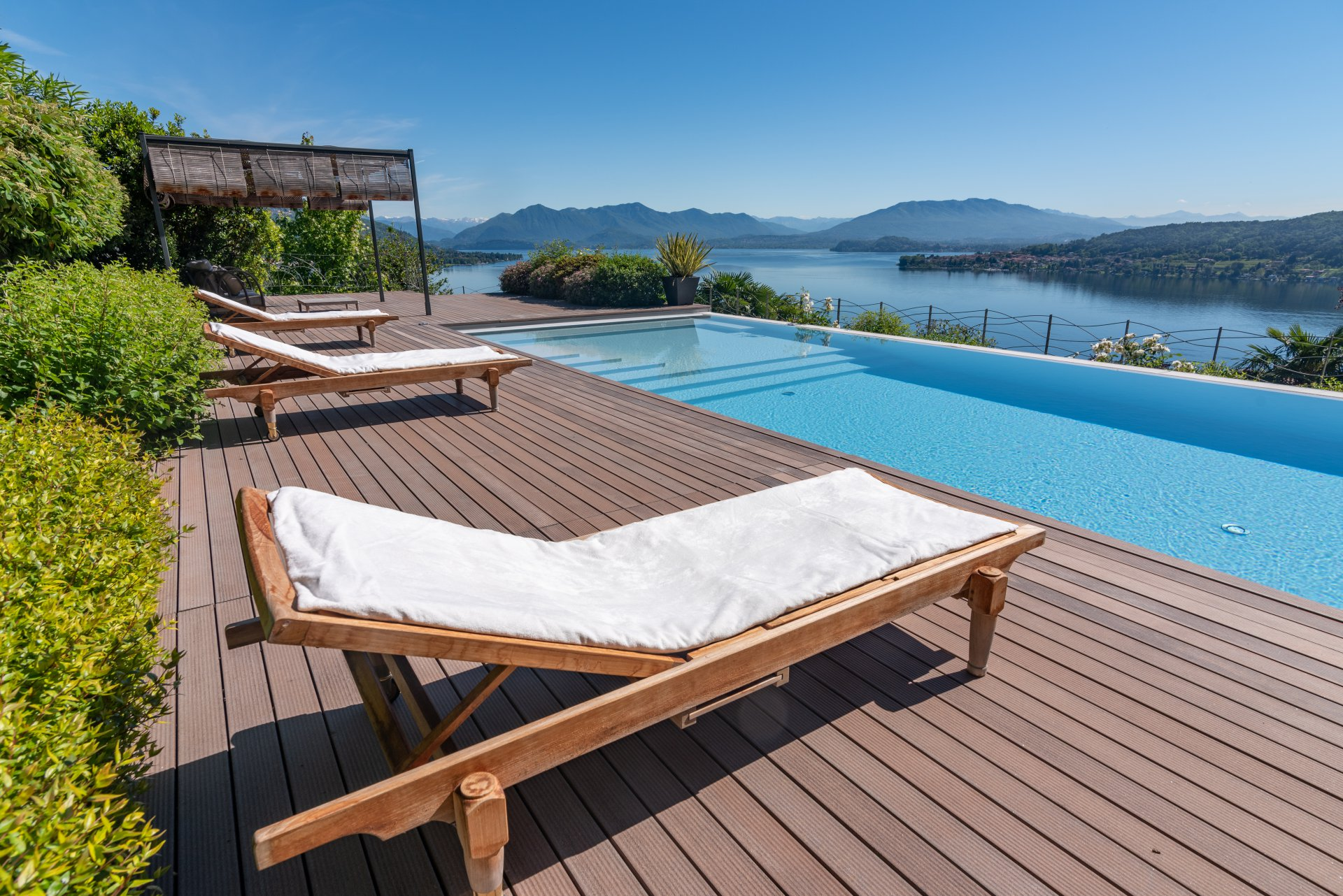 Infinity pool with panoramic view on lake Maggiore