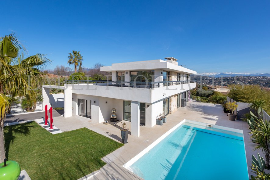 Contemporary with views of the village, the snow-capped mountains and the sea