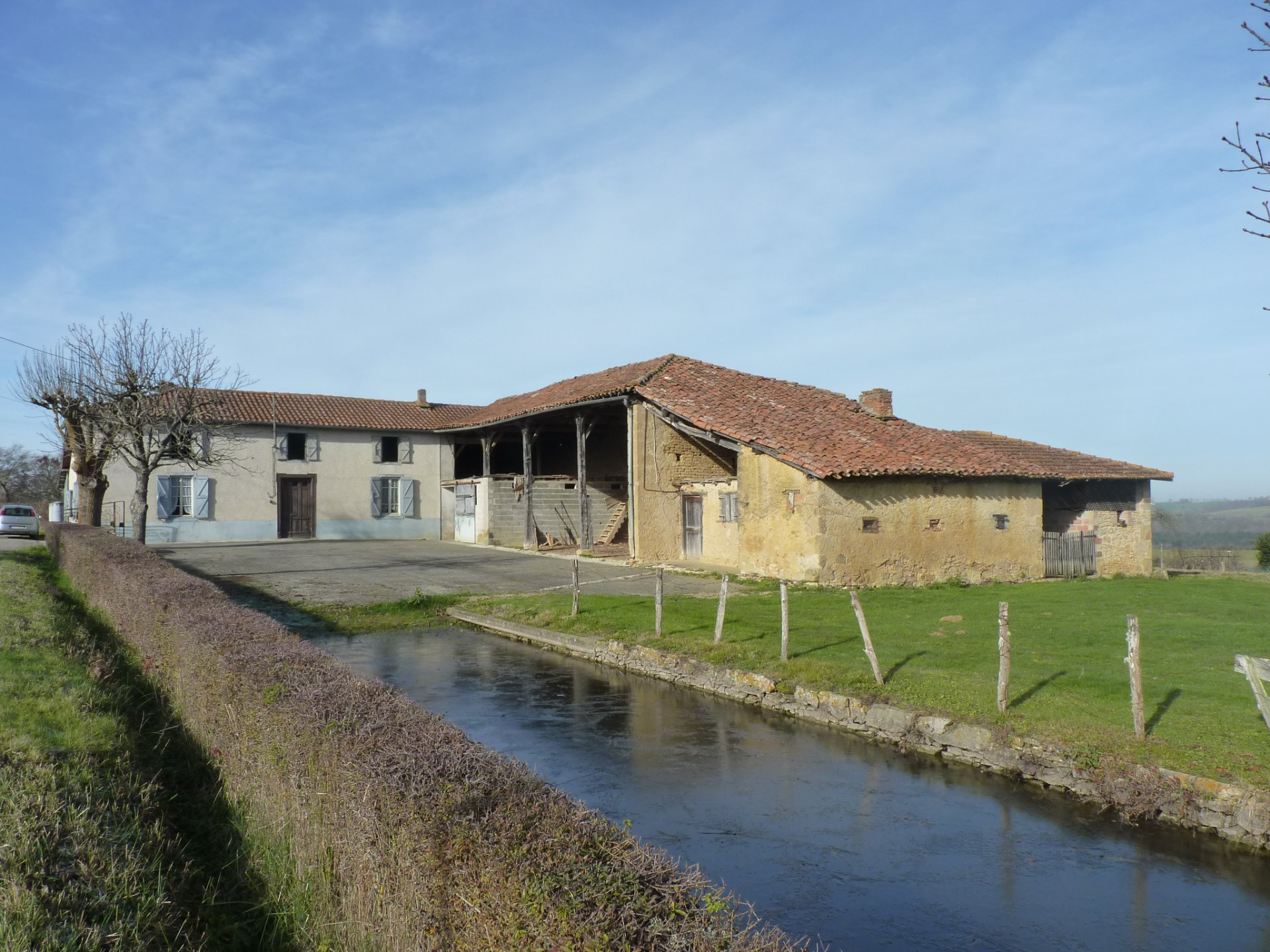 Near Aurignac, farm with large outbuildings Pyrenees view