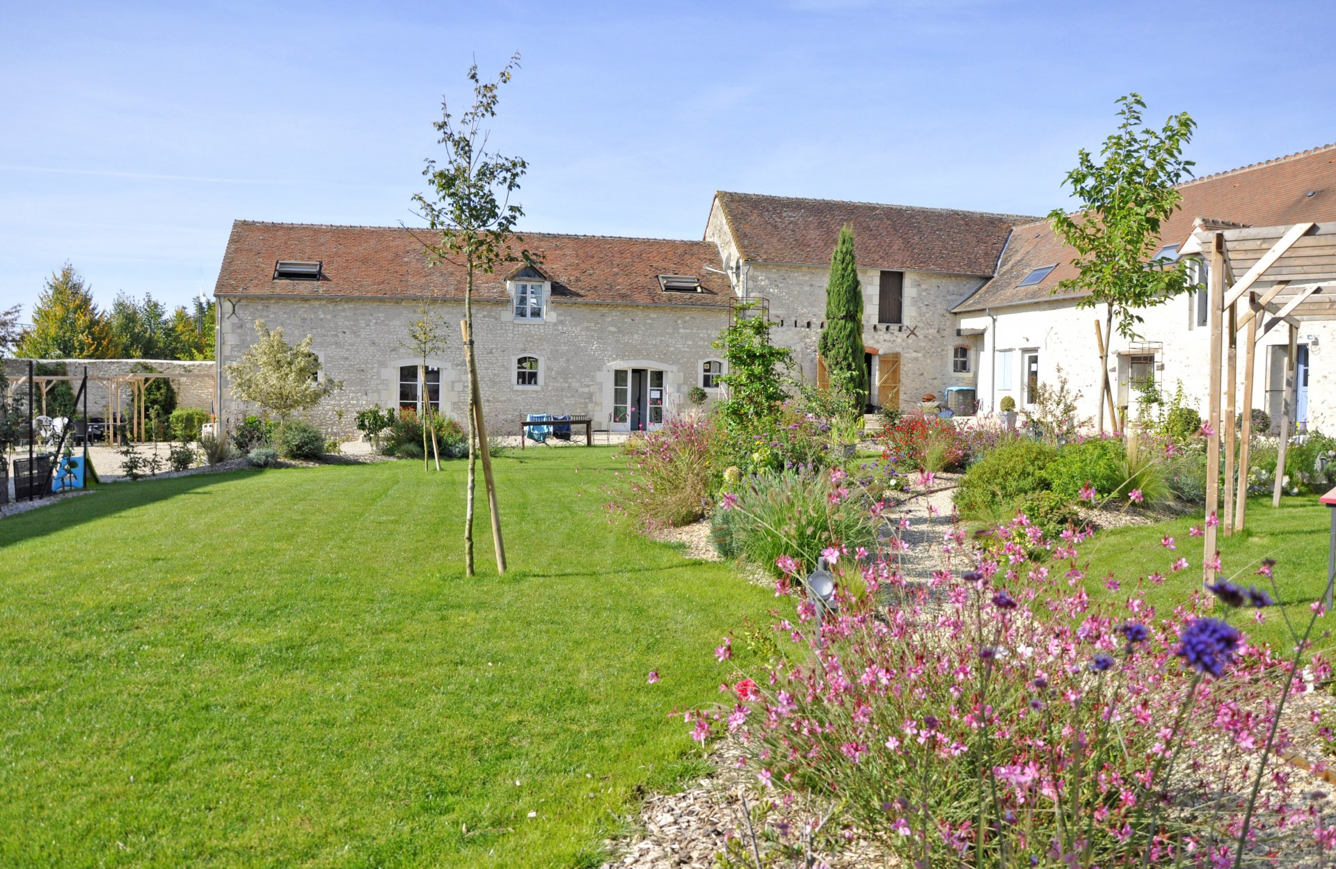 Charming restored farmhouse with horse facilities, heated pool and a cottage rental business.