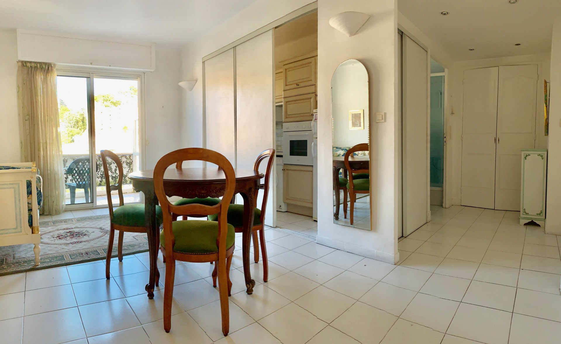 main room, white tiled floor, white walls