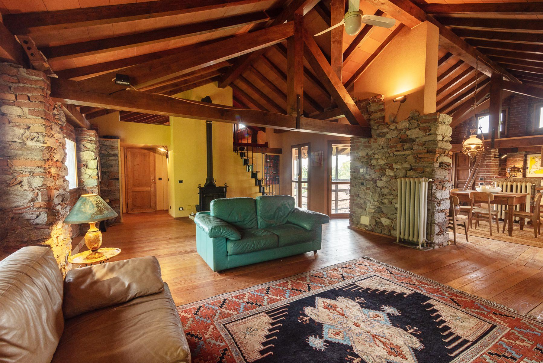 Trait house of land for sale in Paruzzaro- living room with beam