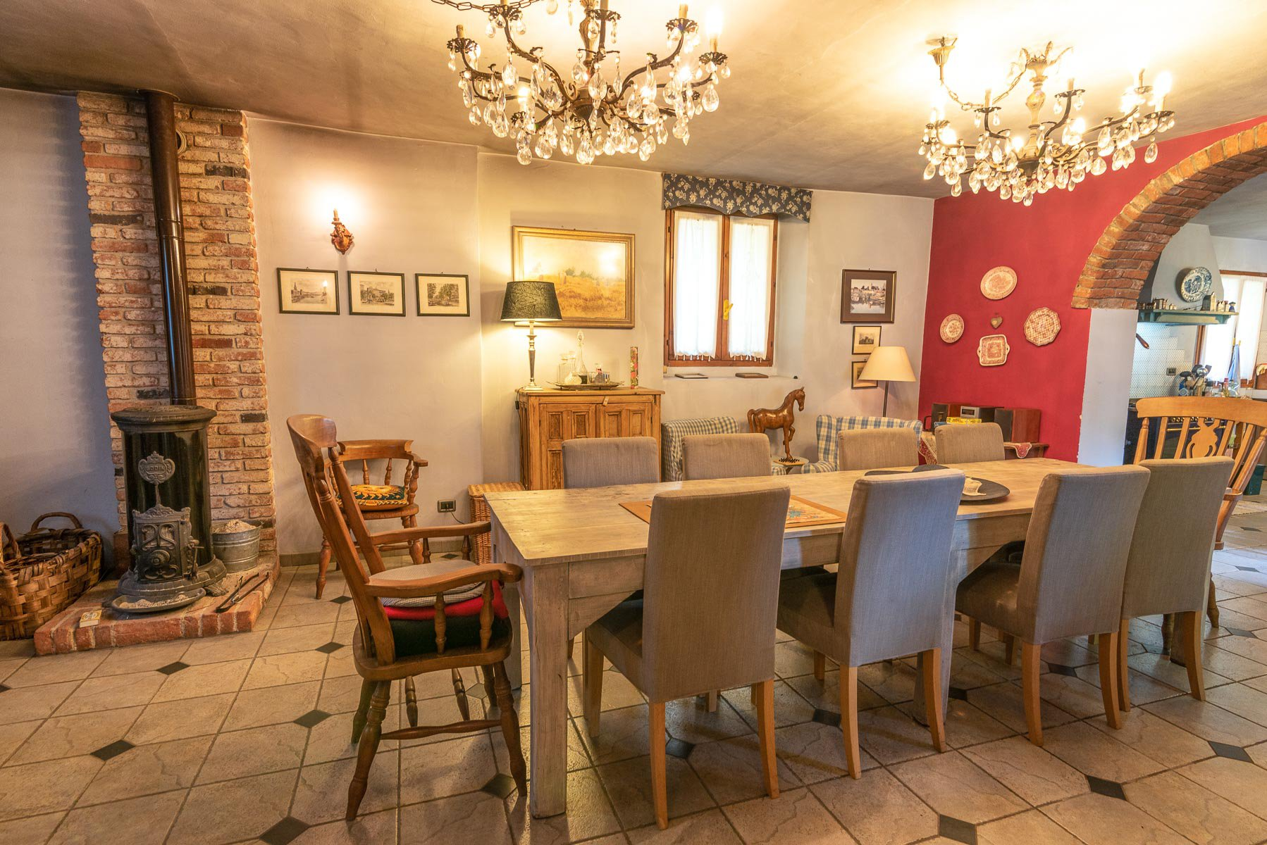 Trait house of land for sale in Paruzzaro- dining room with fireplace
