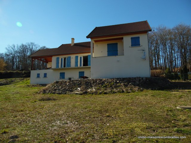 For sale in Auzances, newly built house, double garage, garden and views.