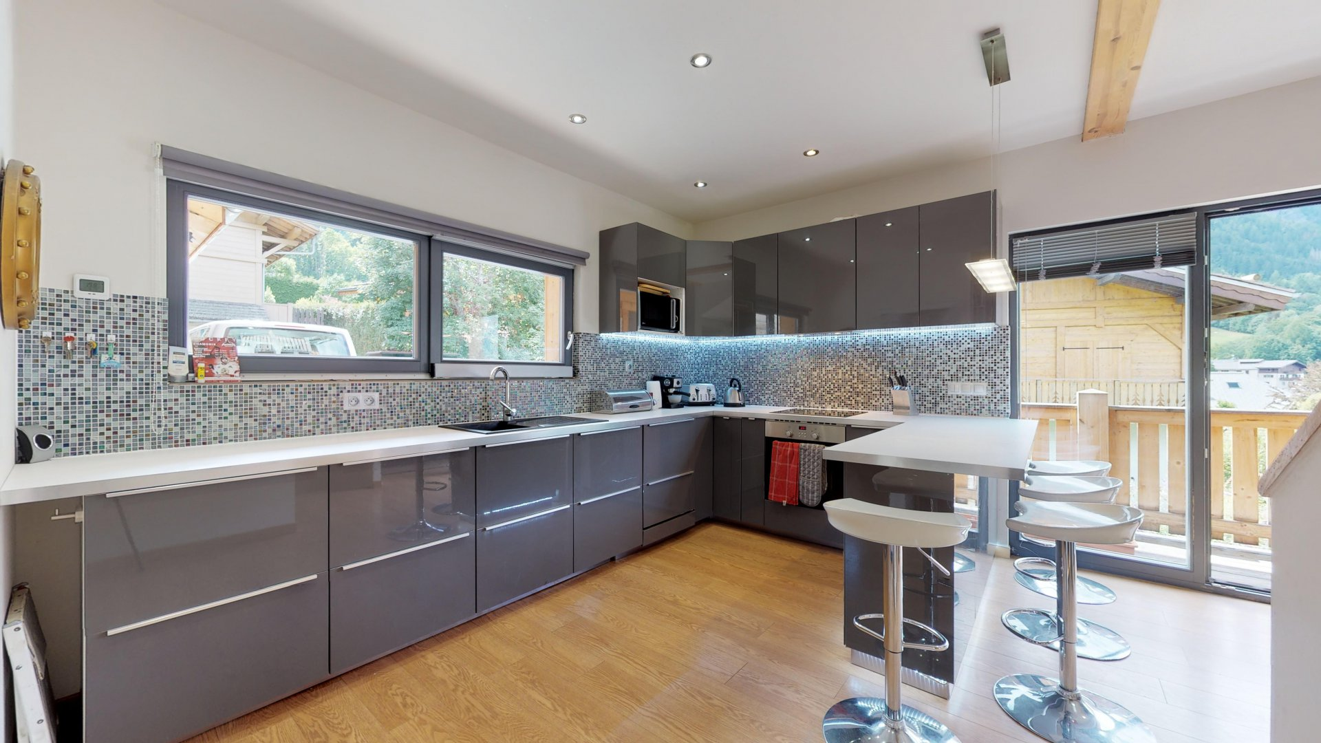 Modern kitchen, spacious, with a breakfast bar