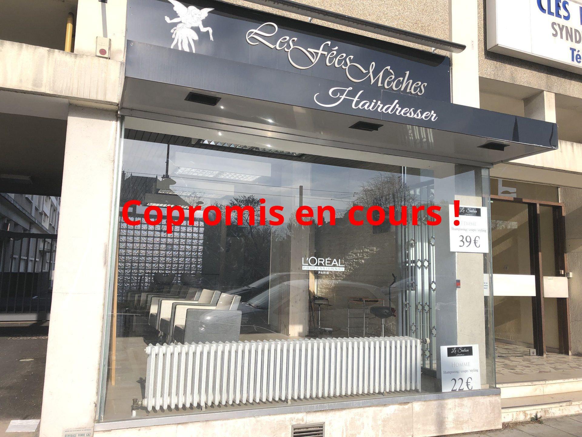 Mûrs de magasin 88 cours de la Libération