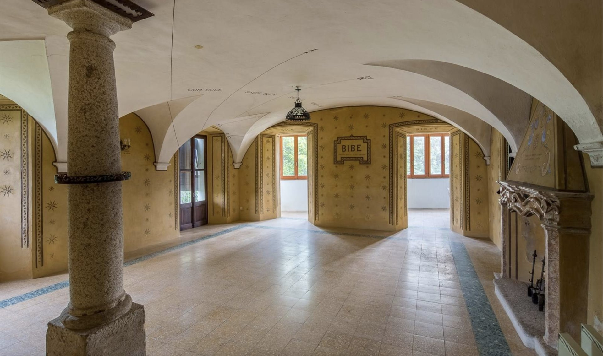 Historic property former convent for sale in Orta - fireplace salon