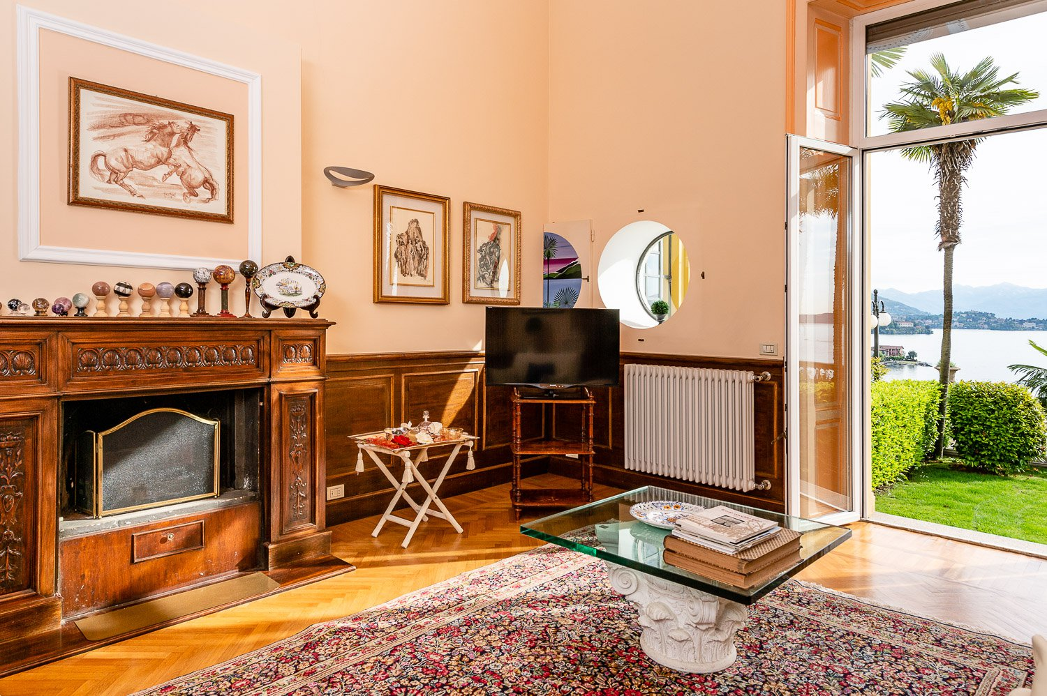 Apartment for sale in historic villa in Baveno- living room with fireplace