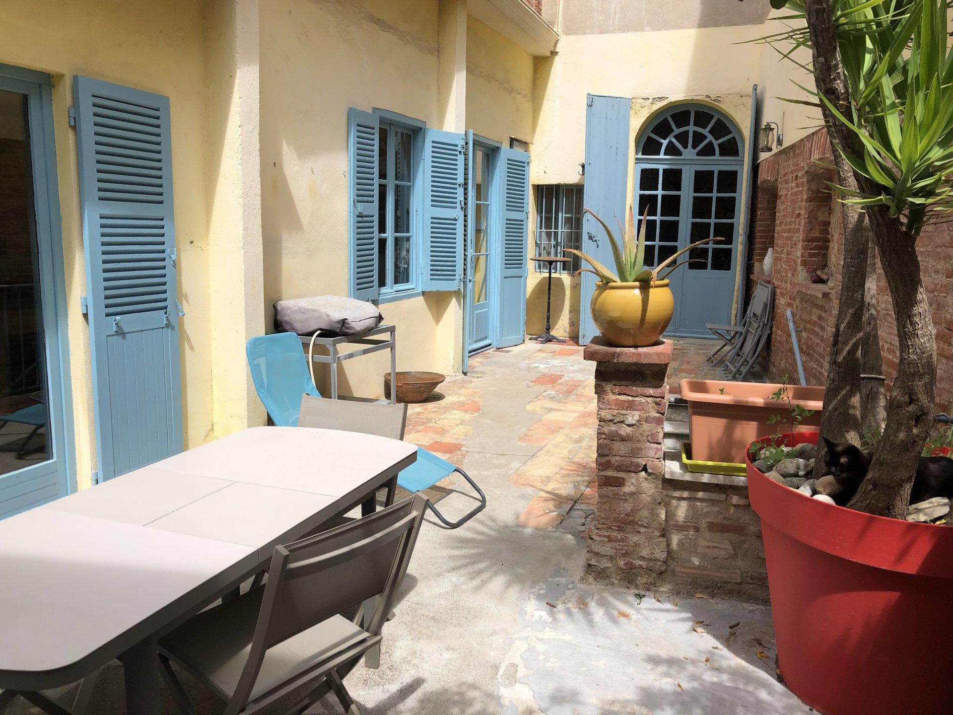 Perpignan appartement de caractère avec très grande terrasse à vendre en coeur de ville