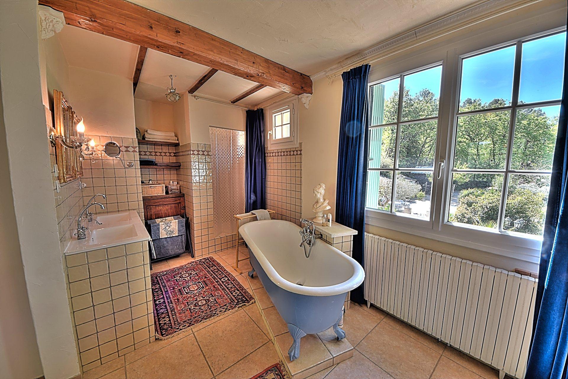 Opened bathroom of the bedroom in suite