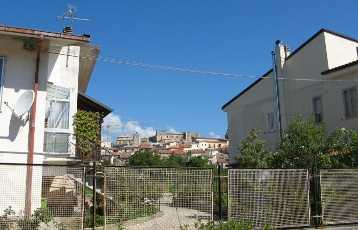 Villa in the town center with terrace and land
