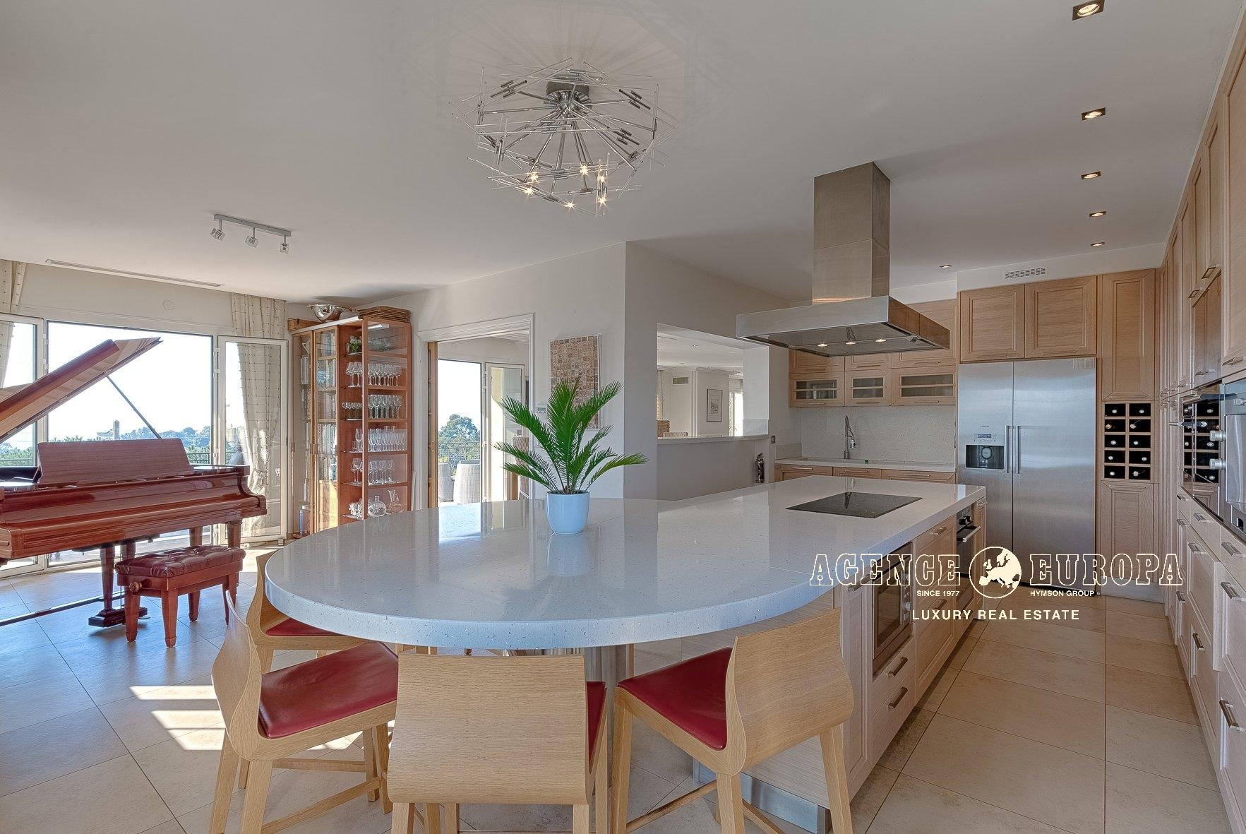 Stainless steel, natural light, kitchen bar, kitchen island