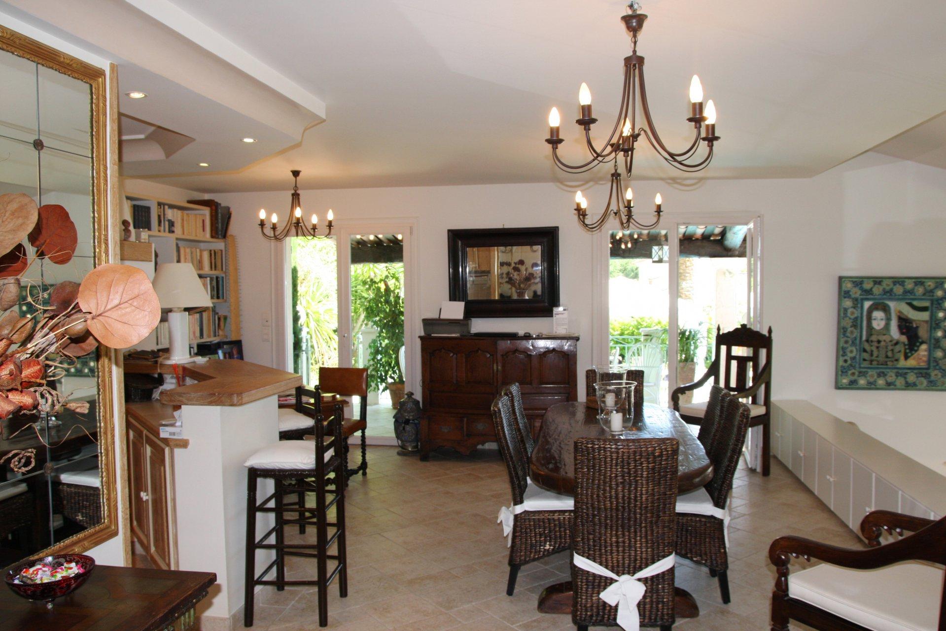 Chandelier, natural light, kitchen bar