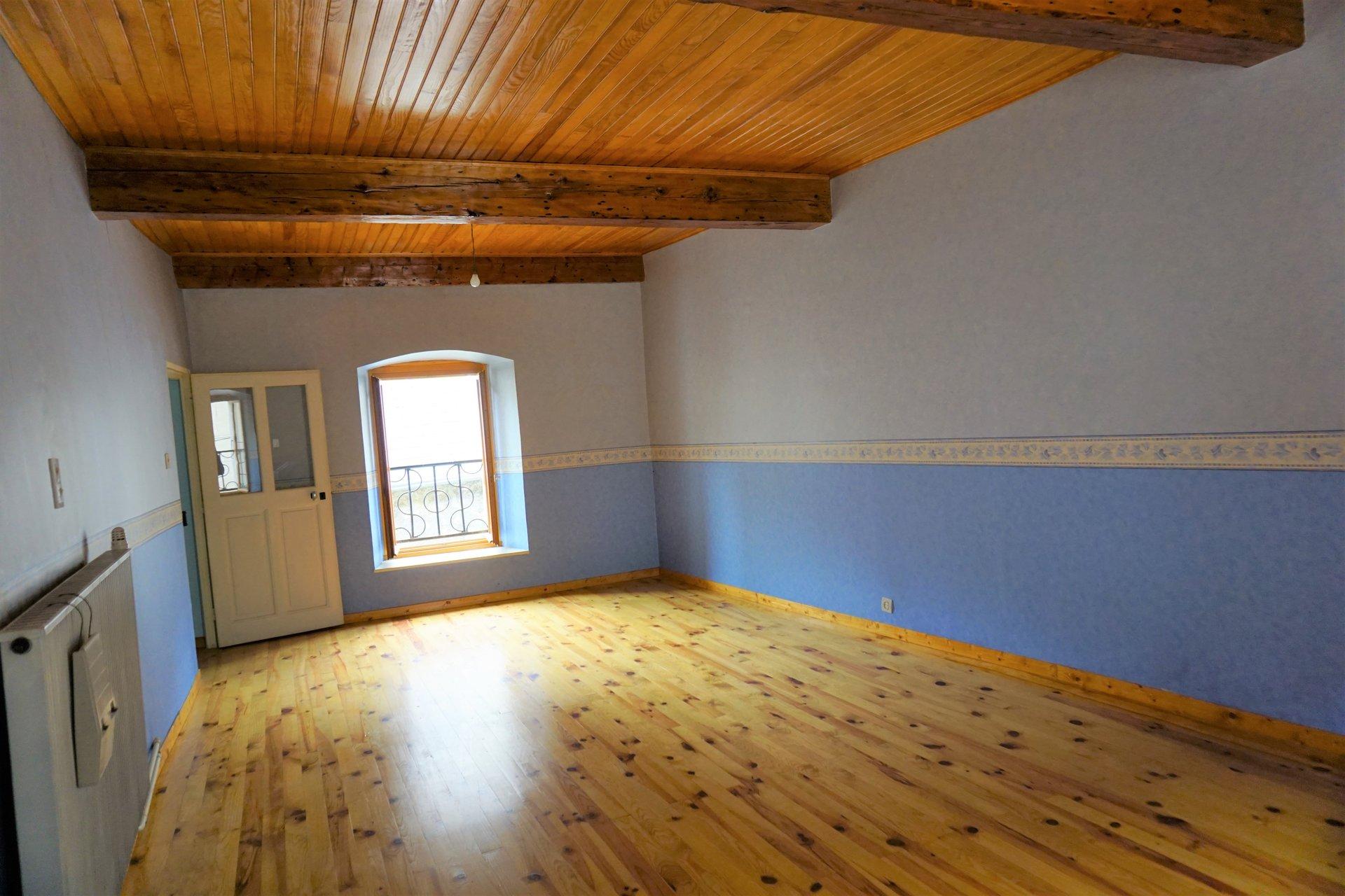 Très belle chambre avec poutres et parquet