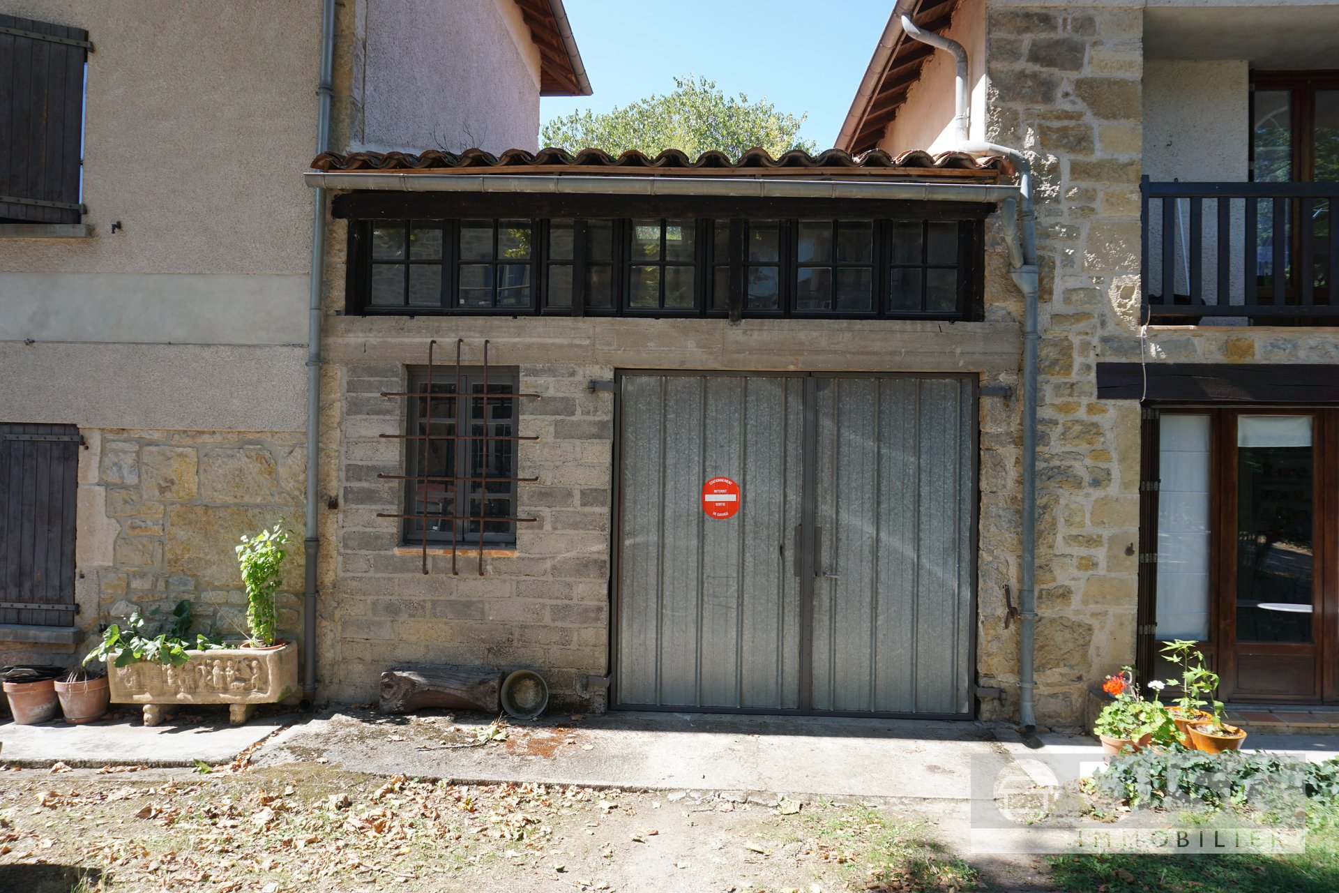 Village house with garage and garden.