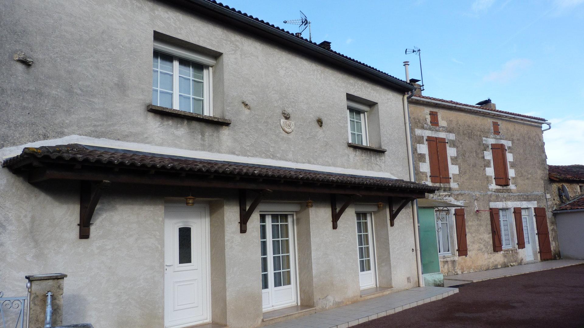 2 adjoining village houses
